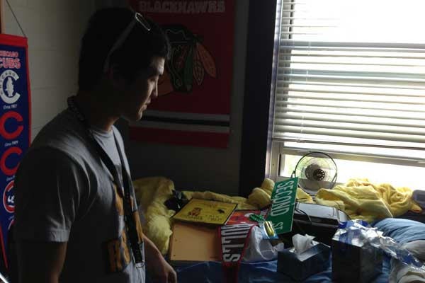Typical student in his cluttered dorm room