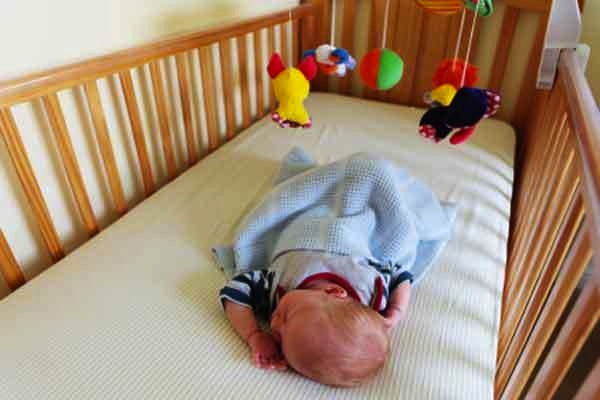 What is a safe crib mattress?